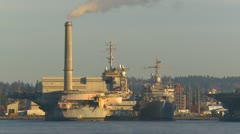 Military, Naval Base Kitsap and ships in dock, smoke stack, early morning Stock Footage