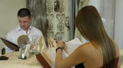 Couple chooses dishes from menu Stock Footage