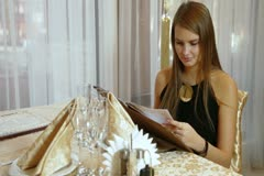 Young woman in a restaurant Stock Footage