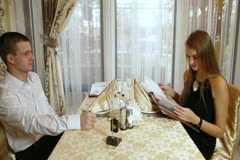 Ordering meal in restaurant Stock Footage