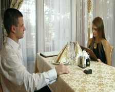 Couple dining out in restaurant Stock Footage