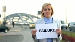 Businesswoman holding paper sheet with FAILURE word by the street HD Stock Footage