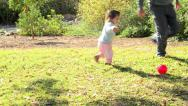 Baby play red ball 01 a Stock Footage