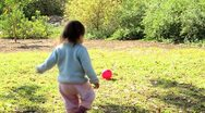 Baby play red ball 01 b Stock Footage