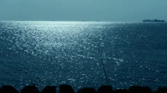 Sparkling water surface and fishing rod,horizon,skyline,Vessel Ship,night. Stock Footage