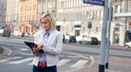 Happy businesswoman with digital tablet in the city HD Stock Footage