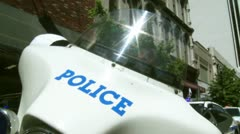 Police Motorcycle with flashing blue lights. Stock Footage