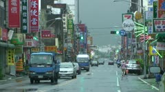 Traffic In Downtown Taiwanese Town Stock Footage