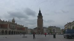 People walking in the main Market Square, Old Town, Krakow, Poland. Stock Footage