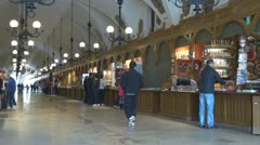 People buying souvenirs in Cloth Hall in Market Square, Krakow, Poland Stock Footage