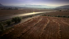 Car on a road between fields - stock footage