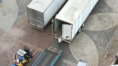 Cool perspective of a Semi truck back being opened in order to load. - stock footage