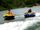 Stock Video Footage of Summer triple teen tubing 3