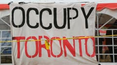 Occupy Toronto. Sign and tent. Two shots. Stock Footage