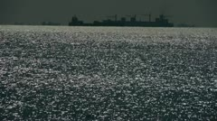 Sparkling water surface and Vessel Ship,horizon,skyline,night. - stock footage