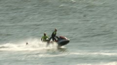 surfing jet ski assist - stock footage