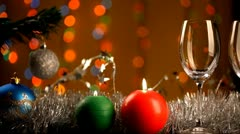 Two glasses of wine over Chrismas decorations background - stock footage