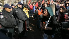 Occupy Toronto. Singing to the police. Stock Footage