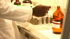 Laboratory flasks is filled Stock Footage