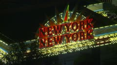 Las Vegas Strip, night, the strip NYNY signage aerial Stock Footage