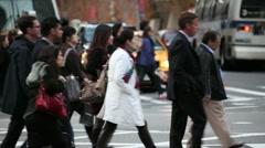Crowd walking slow motion new york urban intersection crossing pedestrian Stock Footage