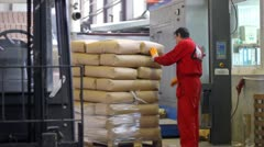 Working on automatic pallet wrapping machine Stock Footage