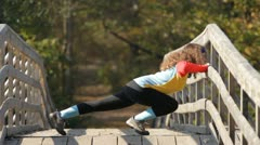 Girl doing stretching exercise Stock Footage