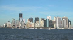 NYC harbor downtown skyscrapers buildings water front Stock Footage