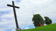 HD: Iron Cross With Church - Zoom out - stock footage