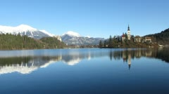 HD: Lake Bled - Church On The Isle With Snowy Mountains Stock Footage
