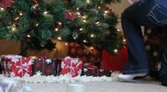 Stock Video Footage of Christmas Presants Under the Tree