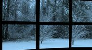 Stock Video Footage of Snowing at dusk seen through a black metal window