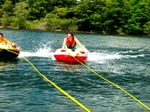 Stock Video Footage of Tubing from motor boat 2