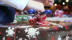 A bow on a Christmas Presant - stock footage