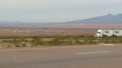 Fed-Ex truck traffic on the desert, triple trailer, medium shot Stock Footage
