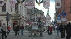 People walking on Grodzka Street, Old Town Stock Footage