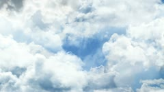 Through the clouds in the sky. - stock footage
