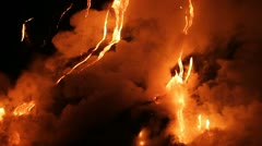 Spectacular nighttime lava flow from a volcano into ocean. - stock footage