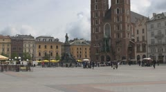 People walking and buying souvenirs in Market Square, Old Town, Krakow, Poland Stock Footage