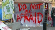 "Stock Video Footage of Occupy (wall street) Calgary tent camp sign ""don't be afraid"""