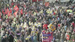 Striking workers at a protest rally Stock Footage