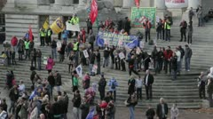 Striking workers at a protest rally with banners Stock Footage