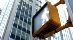 Crosswalk sign with city building in background Stock Footage