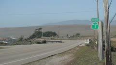 Costal Hwy One near the ocean with Hwy one sign - stock footage