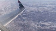 Stock Video Footage of Midwest Snow2-35-High alt over City-wingside