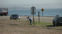 Man taking pictures near the ocean  Stock Footage