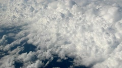 Billowy clouds over ocean - stock footage
