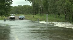 Car Drives Through Flooded Road Stock Footage