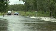Stock Video Footage of Car Drives Through Flooded Road