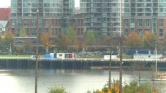 Skytrain and condos on False Creek, Vancouver Stock Footage